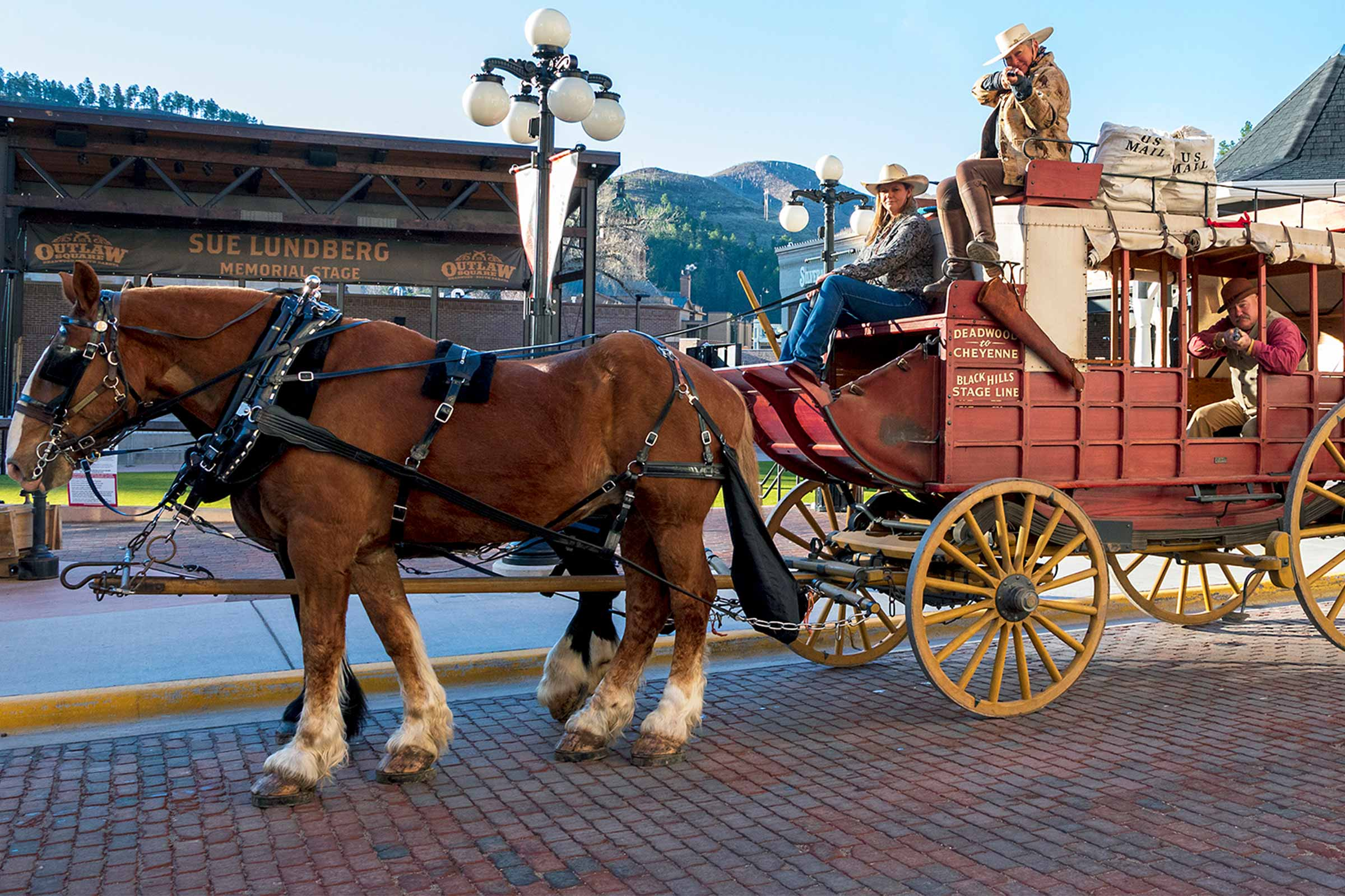 Deadwood Stagecoach with passengers pulled by horses